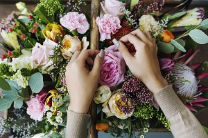 Hands Making Flowers Arrangement