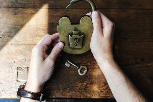 Hands Holding Unlock Padlock