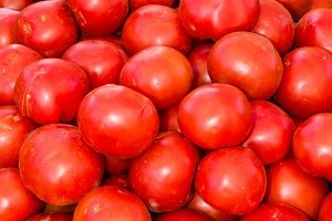 Red tomatoes and market