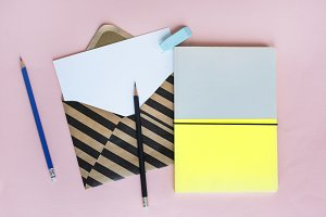 Stationery on Pink Background