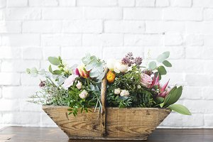 Beautiful Flowers in Wooden Basket