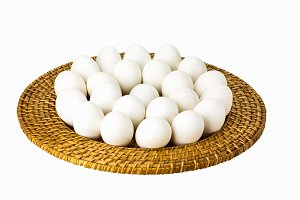 White eggs on wicker tray