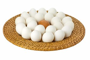 White and brown eggs on wicker tray