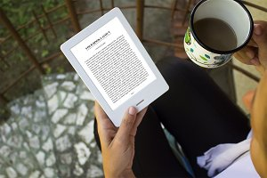 Girl using E-Book Reader, Outdoor