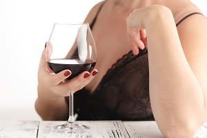 Female with glass of red wine