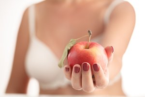 Apple in Human Hand