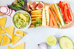 guacamole with vegetables and snacks