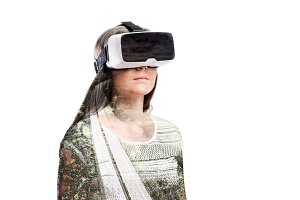 Double exposure. Woman with virtual reality goggles. Highway.