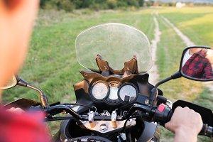 Unrecognizable man enjoying a motorbike ride in countryside.