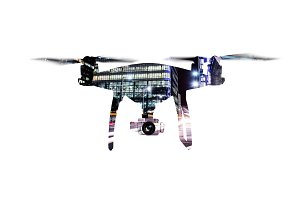 Double exposure. Hovering drone and city at night. Isolated.