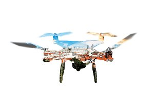 Double exposure. Hovering drone and roofs of buildings in the ci