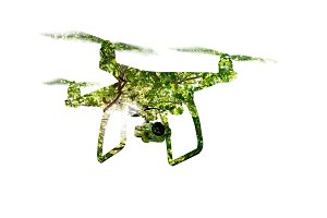 Double exposure. Hovering drone taking pictures of green trees.