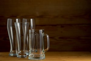 Beer glasses on a wooden background