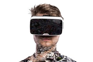Double exposure. Man wearing virtual reality goggles. City.