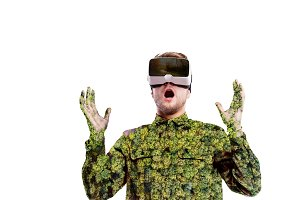 Double exposure. Man wearing virtual reality goggles. Forest. Trees.