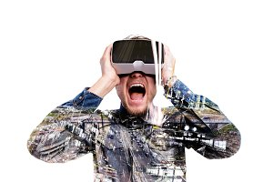 Double exposure. Man wearing virtual reality goggles. Highway.