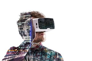 Double exposure. Man wearing virtual reality goggles. Night city