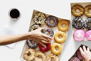 Hands Reaching Donuts