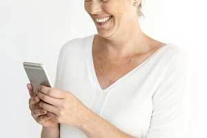Woman smiling while using phone