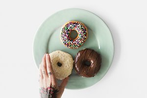 Hand reaching for donut