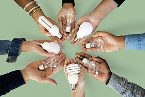 Hands holding light bulbs