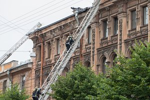 Saint Petersburg, Russia, on the morning of September 13, 2017. Firefighters extinguish a large fire on the roof of a residential house on the street Tchaikovsky 31