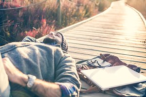 man lying on a catwalk