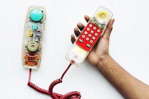 Holding telephone