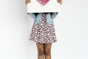 Woman holding banner cover face