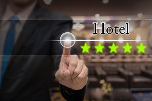 Businessman pointing five star