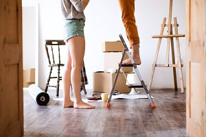Unrecognizable couple moving in new house.