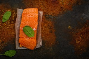 Raw fresh salmon steak with spinach lieaves