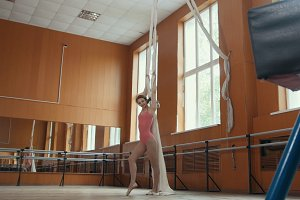 Portrait of a graceful girl ballerina practicing in the studio