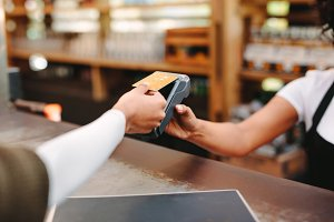 Customer paying bill using card