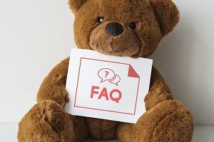 Bear doll with an FAQ card
