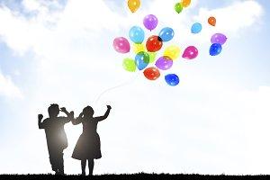 Children Outdoor Holding Balloons