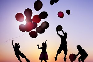 Children Outdoor Holding Balloons