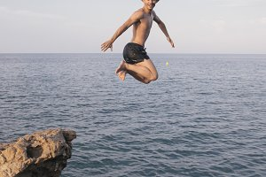 Man jumping the sea