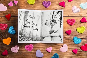 Photo of senior couple in love, colorful fabric hearts. Studio s