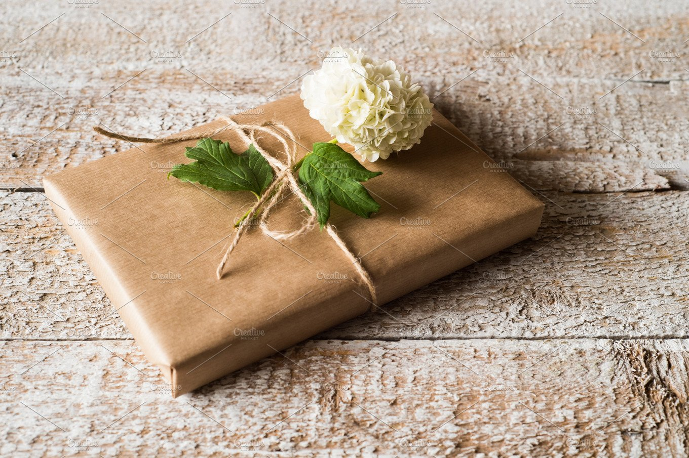 Present Wrapped In Brown Paper Lilac Flower Laid On It Nature