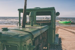 Tractor on the sandy beach of the Baltic