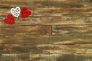 Red Hearts Hanging over Brown Wooden Background