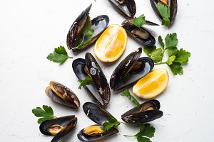 Boiled mussels on white.