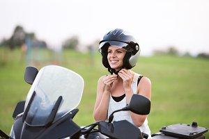 Pretty blond woman enjoying a motorbike ride in countryside.