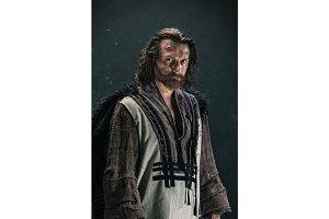 Actor in makeup, a poor man in a suit