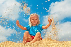 Happy child throwing up raw grains