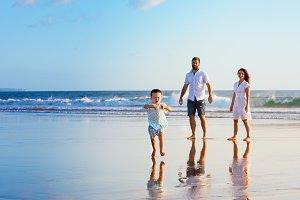 Happy family on sunset beach