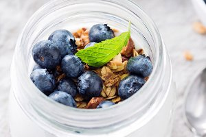 Greek yogurt with blueberries and granola in a jar