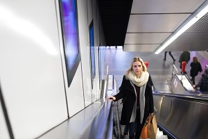 Young woman standing at the escalator in Vienna subway
