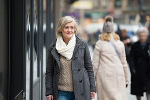 Beautiful senior woman on a walk in the city. Winter